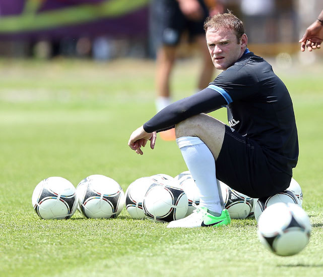 Wayne Rooney takes a break during an England training session ahead of UEFA Euro 2012 on Thursday. The English team will be without Rooney, who is serving a two-game suspension, but SI's Grant Wahl still predicts them to reach the quarterfinals. (Scott Heavey/Getty Images) WAHL: Euro 2012 Tournament PreviewGALLERY: Rare Photos of Wayne Rooney