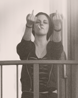 Kristen Stewart giving middle finger to Paparazzi