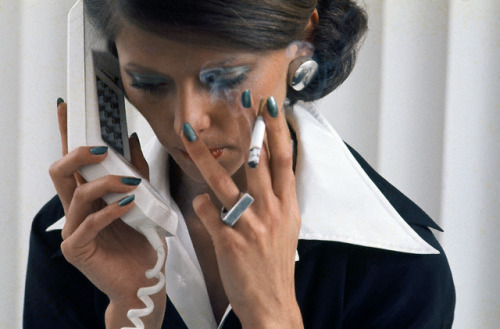 1972  by dovima_is_devine_II on Flickr.Via Flickr: Model is on the phone with a cigarette in hand, Pearly Green polish by Revlon, black and white shirts from Saint Laurent Rive Gauche, silver ring and earrings by Donald Stannard, makeup and hair by Franklyn Welsh.  Image by © Condé Nast Archive/CORBIS