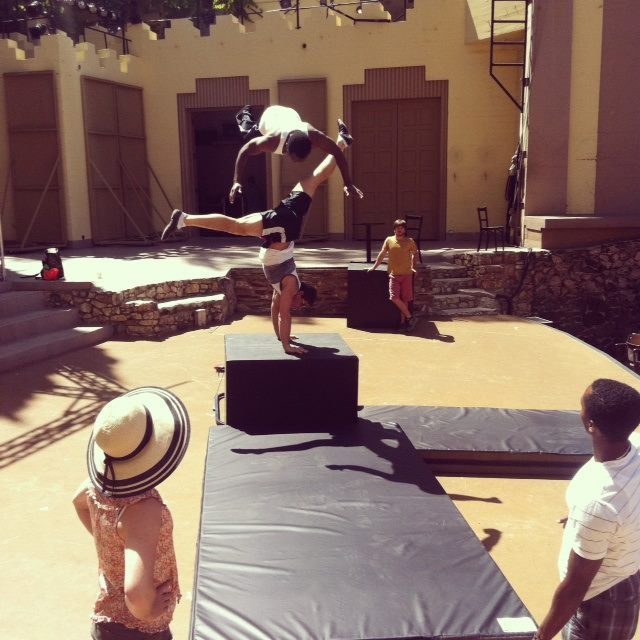 Acrobats flying! Photo by performer, Erin Cervantes.