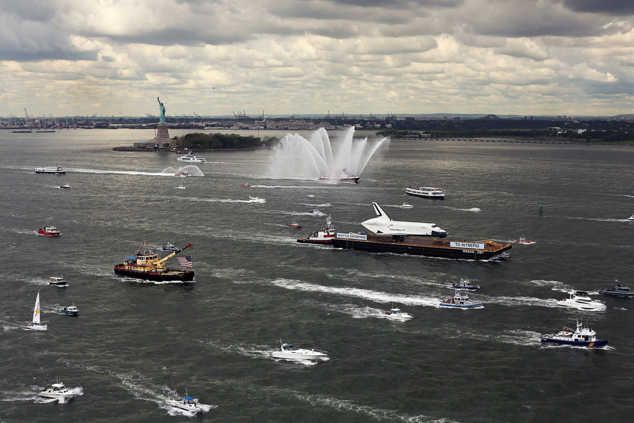 Spencer Platt—Getty Images A flotilla surrounds the NASA space shuttle Enterprise as it is carried by barge past the Statue of Liberty up the Hudson River, en route to its permanent home at the Intrepid Sea, Air and Space Museum on June 6, 2012 in New York City. See more here.