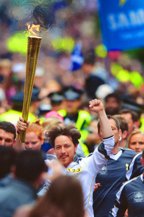 azryal00:  blue-bass:  James McAvoy | Carrying Olympic Torch in Glasgow (06.08.2012) (x)  You. Adorable. Remarkable. Man.  He really is, and damn still rocking the grey 'rogue' streak. The lad even goes grey with class XD