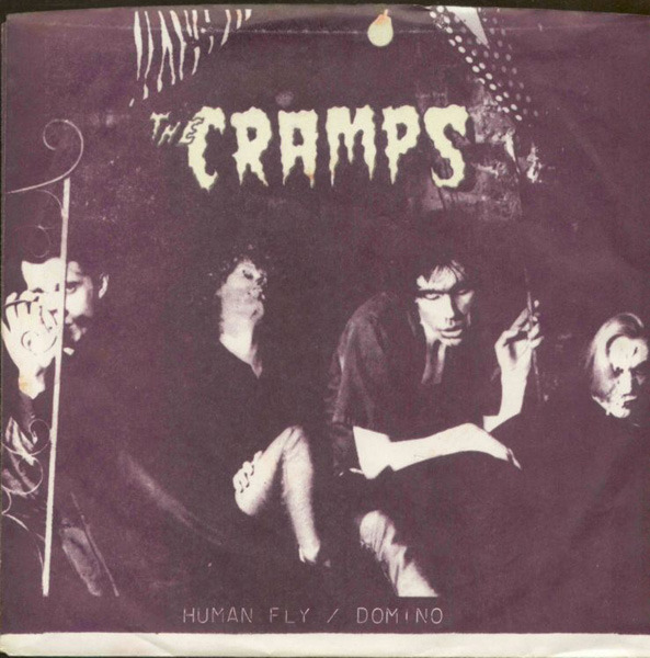 "solarflares:  whorehousepiano:  The Cramps - ""Human Fly"" b/w ""Domino"" - Vengeance Records 1978 OK, so maybe I'll spill a little ink for these miscreants after all. Now, it's easy to want to think of The Cramps as being somewhat of a novelty act, a novelty for me that wains with every wave of countless latex bustier and crepe-sole-creeper-clad Hot Topic punks, sporting Betty Page do's and pompadours, pumping out exaggerated power-pop-punk ever so crudely tinged with only the slightest hint of Rock 'n' Roll history that has followed. And, It's hard not to want to throw the originators on to the fire along with their idiot children. Considering The Cramps role, along with the likes of The Misfits (perhaps an even more egregious offender) in defining a musical subculture I find by-in-large creatively and stylistically bankrupt and that my tastes tend to lean toward the darker, bleaker, grittier, even political tones of the day, it might be difficult to reconcile my love for the band. A band that cannibalized and enlisted the cultural residue and collective paranoia of the 50's and 60's, as manifest in Atomic Horror, Drug Panic, and Pulp Sexual Deviation into the service of a little bit of fantasy if not some outright escape from the real horror of the late 70's and 80's, looks on paper to be about as appealing (well maybe a bit) as the plots of most lesser pulp novels, that is to say, likely boring, and ultimately all tease. But like any good pulp, the best part is the wrapper(admittedly a tease, but usually an arousing and necessary one), and that's what The Cramps had in spades, style, a look, sex and a certain believable depravity. My earliest memories of encountering The Cramps are from the age of thirteen, a friend who was a few years older had a Cramps poster, circa Psychedelic Jungle (maybe, these things are fuzzy), attached to the door of his bedroom. Upon first catching a glimpse of the poster I was mesmerized, horrified. Like spotting some gruesome car accident, I couldn't take my eyes away, and gawked like the most shameless ghoul. Three emaciated, skull faced, lanky transvestite motherfuckers stared back, and I don't mean the all-of-a-sudden safe, mundane, boys-in-high-heels-and-rouge drag of the New York Dolls, but instead some serious back-alley-junky-dive vibe shit. My thirteen year old mind couldn't tell he from she or what and loved it. Then there was Ivy, with her huge shock of tangled red hair, all-at-once alluring and frightening, her expression that of a great white MANEATER. I mean I literally thought she ate men for breakfast, fully grown men, and I thought ""my god what would she do to my puny teenage self?"" Here were these ugly, gross, beautiful, real people, and the sounds that spilled from their monstrous maw was no less disturbing to my fragile teenage psyche, a lurid, technicolor grotesquerie of americana, with that perfect dash of black humour. Who else but a band that one would likely flee from in terror in a chance encounter on a dark street could make a song like GOO GOO MUCK sound as sinister, as it is laughable, and a song like HUMAN FLY as perverted and sexy as it is catchy. My fate was sealed the second my eyes locked with Ivy and Lux's menacing gaze, and no poser, pastiche, or impostor will ever break that spell.   Amazing how this echoes my own experience. I discovered them around age 14, while hanging out at a friends house during Xmas break- he was a punk, with the leather jacket, Exploited tee and everything—- in other words, cool as fuck. While flipping through Crass, Suicidal Tendencies and Circle Jerks records, I found Gravest Hits- for a kid with a curfew, the back cover pic of the band performing at the Palladium and the liner notes - ""In the spring of 1976, The CRAMPS began to fester in a NYC apartment. Without fresh air or natural light, the group developed its uniquely mutant strain of rock'n'roll aided only by the sickly blue rays of late night TV."" had a dangerous, glamourously grown-up and badass aura.  Of course it did. 14 years old, just discovering punk, counterculture, girls…Winnipeg, River Heights, winter- the fabled Lower East Side seemed like an alien planet, and NYC's allure got its hooks into another prairie boy. After that first exposure to New York City as icon/fantasy, it remains a city I have yet to visit, mostly because time machines haven't been invented yet and I don't want to bear the disappointment: the New York I want to move around in won't be the rain-slicked boroughs of The Warriors and the artsy types and fuck-ups won't be half as glamorous or interesting as the ones in After Hours, Downtown '81, Blank Generation, Paris is Burning, Warhol films, or even 9-1/2 Weeks or Desperately Seeking Susan or Mad Men or Blue Note album covers or[[insert film here]]. Oh, the music? Coinciding with the hormone boom that imprints on your libido like wet cement (I still have an uncannily -ahem- Pavlovian reaction towards classic Siouxsie-looking punk girls 20+ years on…), listening was like opening a trap door. The opening tremolo of ""Human Fly"" still gives me goosebumps and makes my eyes roll back in my head like a drug when the rest of the band kicks in. Plus, it sounds like Lux singing right in your ear. BUZZZZZZZZZZZZZZ. Sexy? Creepy? Yes. So yeah, right with ya there, bud."
