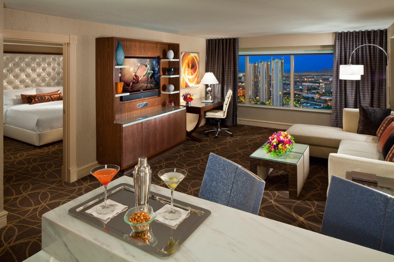 The Penthouse City View Suite was designed to indulge. Get glittering city views of the Strip in this stunning penthouse suite. This inspiring suite boasts a wet bar, separate dining area for four, oversized marble bar, and a spacious living room with sleek furnishings. Inside the private master suite, you'll find a king-sized bed, plush robes and slippers and a large bathroom with whirlpool tub and classic Carrera marble accents throughout. Welcome to the good life. Your dreams have come true. Book a new Penthouse City View Suite today by clicking here.