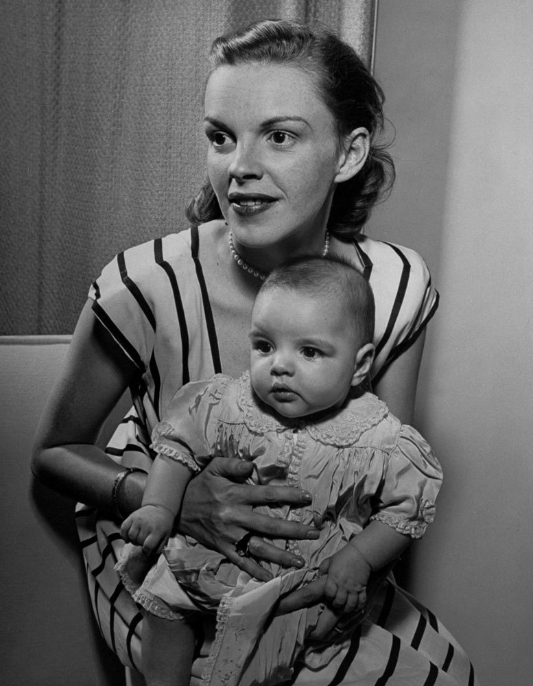 life:  On this day in 1922, Judy Garland is born. Happy birthday, Judy. Pictured, Judy Garland holds her daughter, Liza, at home in Hollywood in 1946. See more photos here.