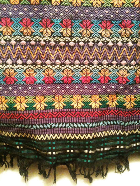 May 2012 Richly coloured, well loved woven blanket stumbled upon in the depths of the closet at our accommodation in Austin, Texas. .