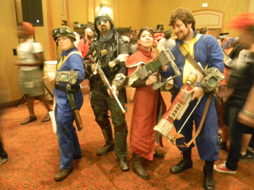 Me and my friends at A-kon 23 this past weekend. I'm the Brotherhood Scribe, my husband is the vaultdweller on the right and my BFF Heather is the vaultdweller on the left. The dirty tribal is just someone we picked up along the way. :)