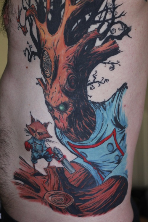Yo. This Skottie Young Groot & Rocket Raccoon tattoo is THE BUSINESS! via fuckyeahtattoos:  Back in December, I sent you posted a picture of the outline and shading, so I thought I'd send an updated picture now that it's all finished. After 12 hours and three sessions, my Rocket Raccoon and Groot (based off of AWESOME Skottie Young art) is finally complete! Thanks to Mike at West Side Tattoo (http://westsidetattoo.net/)in Colorado Springs for doing such amazing work!