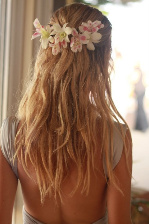 Having a beach wedding? Try wavy hair and a flower halo!