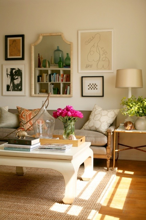Tan Velvet Couch + Mismatched Wall Art + A Gold Armadillo + Fresh Flowers