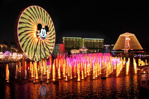 disney—magic:  The Wonderful World of Color… by Ring of Fire Hot Sauce 1 on Flickr.  I EFFING LOVE WORLD OF COLOR!!!!!! Last night was my second time seeing it, and honestly I can tell you already I will NEVER get sick of it. The first time I was front row, smack dab in the middle. Experiencing World of Color that close is something everyone should do. I got soaked, but it was worth it. Last night I was in the blue handicap section, and while our view was blocked by this unsightly arched structure, it was amazing nonetheless. It was such a different point of view, yet just as spectacular as the first. Since I was farther back this time I was able to get, like my sister put very nicely, a panoramic view of the show. World of Color in its entirety. I saw so many things I missed my first time because my field of vision was so narrow being so up close the first time.  Don't really understand why this water and light show is such a big deal? You have to see it to believe it. I didn't really get it until I saw it. And both times I was squealing (out loud) with excitement and fascination. My eyes are stimulated every single second for 25 minutes. SUCH EYE CANDY. I would rather watch World of Color than look at a picture of Ryan Gosling shirtless. THAT'S RIGHT. I SAID IT. Now you can either hate, or GO WATCH WORLD OF COLOR!! hahaha