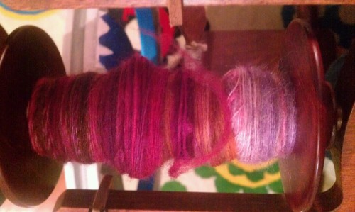 Spinning play for an evening. Fiber is misc wool preparations from a mixed grab bag, dyed by Ceylan of Two if By Hand. Bobbin contents reflects approx 1/3 of around 4oz. Practicing spinning from the fold and some other longer- draw methods, in addition to fooling with color-blending methods