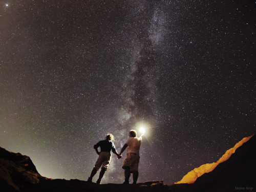 ikenbot:  Milky Way Partners  In a starry night of Sinai peninsula in Egypt, photographer and his partner enjoy the summer view of the Milky Way, not far from the seaside town of Dahab.
