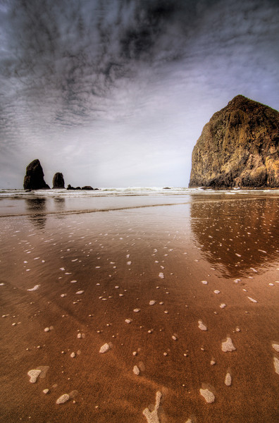 Cannon Beach, Oregon, Oh what a placeMy girlfriend and I spent a weekend there, just touring around seing the sights.  It was of course mostly rainy while we were there, but that didnt dampen our fun.. eh eh get it… dampen!  so hilarious I know.  I think the next time we go will be in July so perhaps we'll have better luck then in getting at least a cool sky pic!