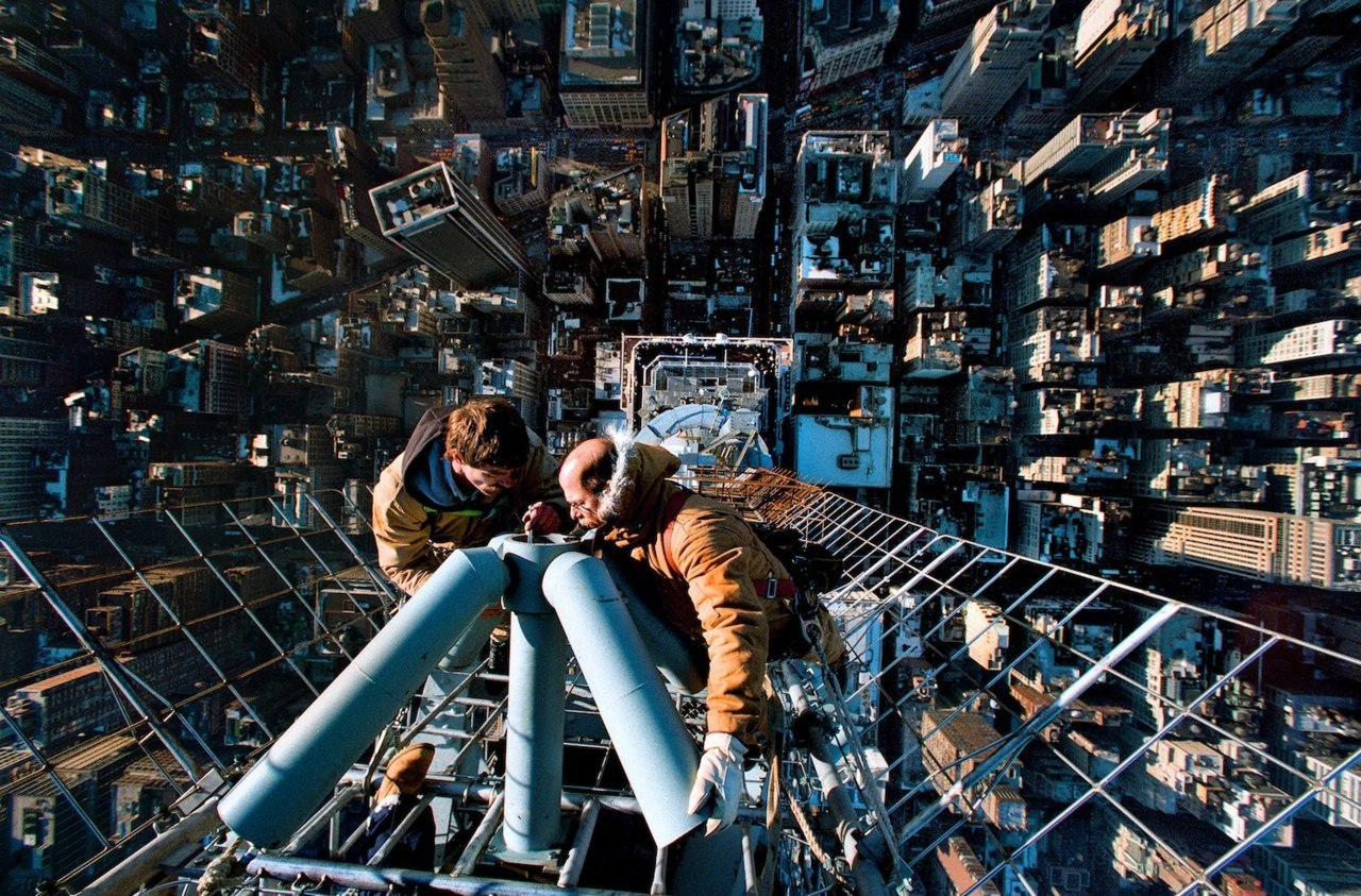 Men fixing the antenna on top of the Empire State Building, New York City. Photo by Vincent Laforet. Read the full story behind this photo here.