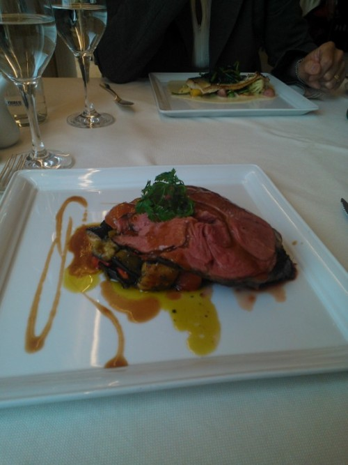 Lamb, cooked sous vide with a pressed garlic au jus served over a medly of grilled summer veggies