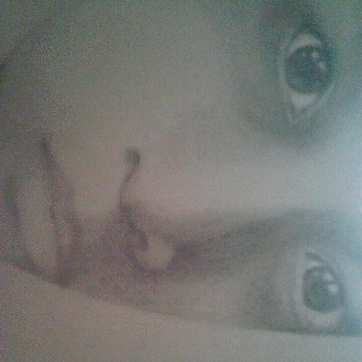"""Realism""  Practice on photorealistic drawing on using my own face as a model."