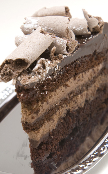 Decadent Chocolate Mousse Torte Rich, dark chocolate cake layers Creamy chocolate mousse filling Finished in a dark chocolate ganache glaze and a crunchy chocolate meringue topping Feeds 8-12 guests