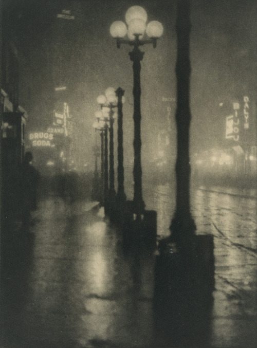 "soircharmant:  Alvis Langdon Coburn - Broadway at night, ca. 1910 photogravure ""Probably there is a man at a switchboard somewhere, but the effect is like destiny, and regularly each night, like the stars, we have this lighting up of the Avenue"" quoted via the Met Museum"