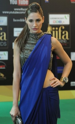 Check out what Bollywood's foreign import Nargis Fakhri was wearing last week at the International Indian Film Academy Awards held in Singapore. Born in Queens, New York to a Czech mother and a Pakistani father, Fakhri made her debut last year in Bollywood in Imtiaz Ali's Rockstar, starring opposite actor Ranbir Kapoor.