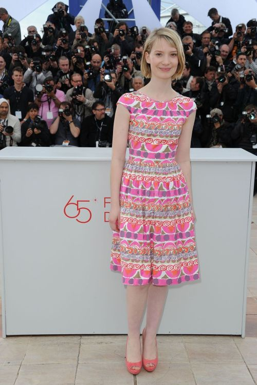 Oh, Prada.  realmofthesenses:  Mia Wasikowska in Prada attends the 'Lawless' Photocall during the 65th Annual Cannes Film Festival at Palais des Festivals on May 19, 2012 in Cannes