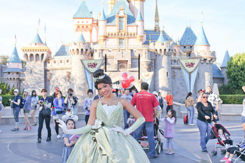 Princess Tiana in Front of Sleeping Beauty's Castle by Disney's Princess Tiana on Flickr.
