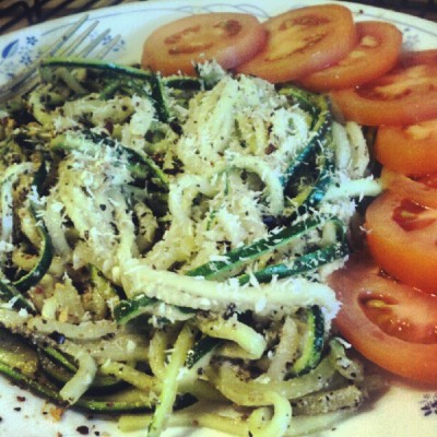 Currently inhaling: #Zucchini #pasta with #basil #pesto sauce and a sliced #tomato. #paleo #food #foodporn #healthy (Taken with Instagram)