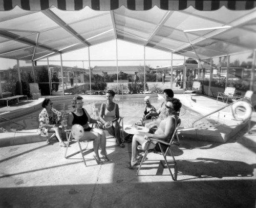 Ladies sit near the community swimming pool: Fort Lauderdale, Florida by State Library and Archives of Florida on Flickr.Look at the photo. Consider what has has just happened here, or what is about to happen here. Who has been here? Who will come here and and what will they do? What kinds of interactions can you imagine? Write one leaf about these or other things that occur to you upon looking at the picture. Do not allow yourself to be limited by what you see. Go.| Write One Leaf + about + ask + random + facebook + twitter | sponsors + You Are a Dog [ Kindle | Google | iBookstore ]