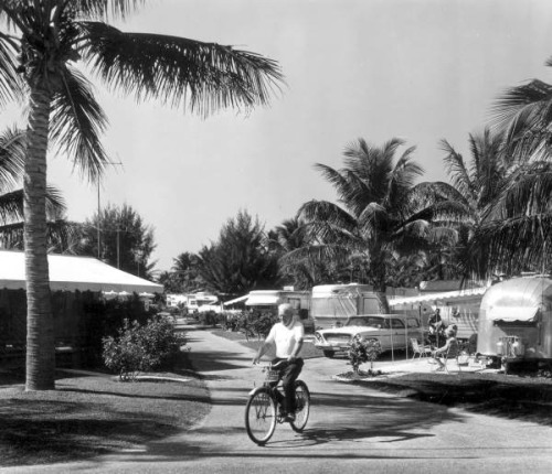 View of the Briny Breezes Trailer Park: Delray Beach, Florida by State Library and Archives of Florida on Flickr.Look at the photo. Consider what has has just happened here, or what is about to happen here. Who has been here? Who will come here and and what will they do? What kinds of interactions can you imagine? Write one leaf about these or other things that occur to you upon looking at the picture. Do not allow yourself to be limited by what you see. Go.| Write One Leaf + about + ask + random + facebook + twitter | sponsors + You Are a Dog [ Kindle | Google | iBookstore ]