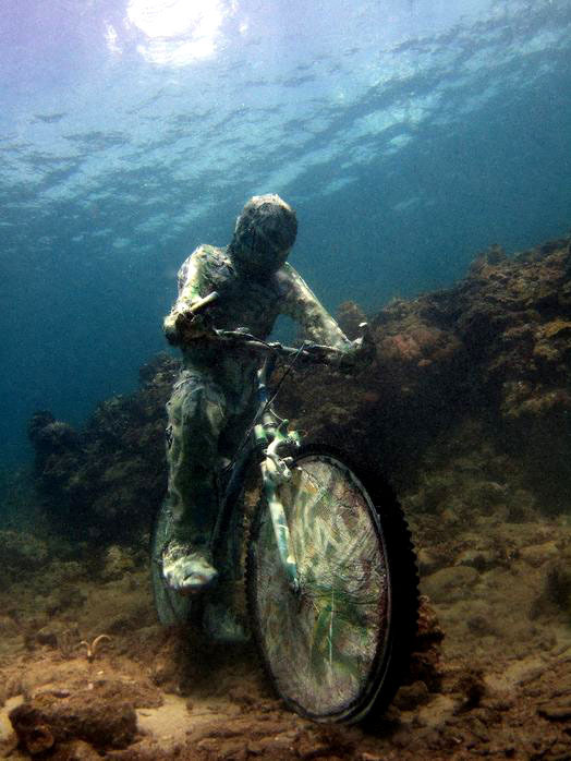 vvolare:  Jason deCaires Taylor is an English sculptor specialising in the creation of contemporary underwater sculptures which over time develop into artificial coral reefs. His projects span from Mexico to Greece, attracting tourists from around the world thus diverting tourists from the natural reefs and providing space for natural rejuvenation.