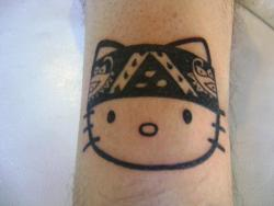 fuckyeahtattoos:  my hello kitty on my leg… gangsta kittydone by my friend alexs elias