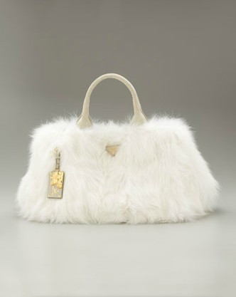 Normally I understand the allure of fur, though I wouldn't buy it, but this just looks like a dead rabbit to me. I wouldn't want it on my arm at a nice dinner unless the plan was to eat it. Prada Fur Open-Top Tote $2,895