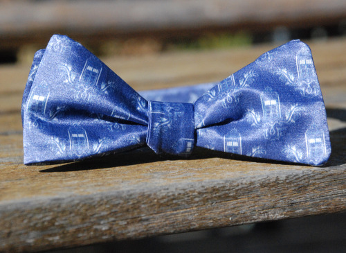 This is over and you can stop reblogging it now. Police Box Bow-Tie Give Away! Hey there everyone! My name is Al and I make bow ties from fabric I design. I just upgraded one of my most popular ties to a new version of the fabric, but I still have a single bow tie of the old fabric laying around. It was a display, but since the ties are going to look different from now on I don't really have any use for it! So I'm doing one of those neato reblog giveaways!  ~The Rules~ -The contest starts immediately and will run until Saturday, June 23rd, 11:59 PM -Reblog to enter. You may reblog once per day max. At the end of each day I'll go through and collect the usernames of the people who reblogged, anyone who has reblogged more than once will have all of their entries up to that point removed from the list. (Subsequent entries will be completely accepted. I am a strict god, but a merciful one.) -Likes do not count, but after this contest ends I'll collect all of the 'likes' and give away a few bow hairclips made from this same fabric. -If you remove any of this text from the post when you reblog, your entry is invalid. -I will contact the winner via their ask box. I'll need to be given an address to ship it to, but I will ship it anywhere in the world for free.  Anyways, that's everything! Put a message in my ask box if you have any questions and happy reblogging!