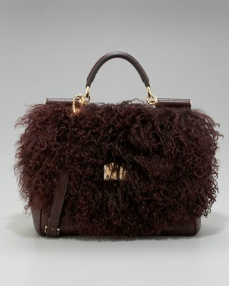Oh god. This purse makes me really uncomfortable. Is that a…merkin…on the front? Dolce & Gabbana Miss Sicily Shoulder Bag $2,575