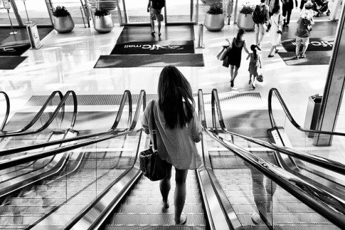 Pretty woman..walking down the escalator. by simonleungxyz on Flickr.