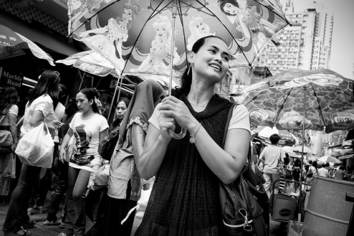 Girl with parasol by Des Crofton on Flickr.