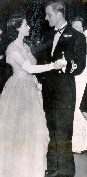 A rare photo of the then Princess Elizabeth and Prince Philip dancing together.