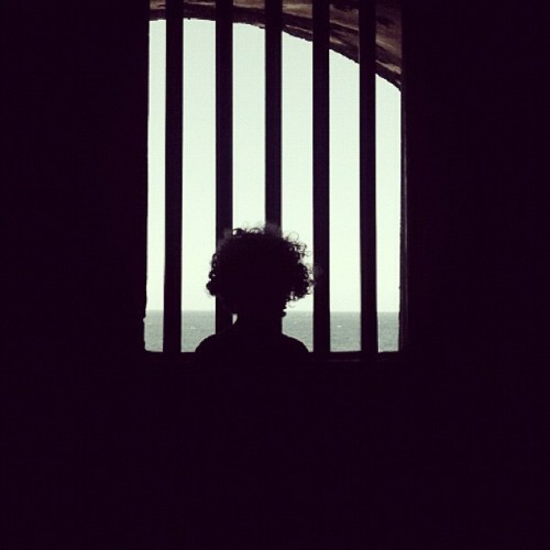 behind bars #puertorico #instagram #iphonegraphy #kids #curlyhair #fun #myson #memory #playing #happiness #instagram_kids #fatherandson #oldsanjuan #morro #fort #light #prision #bars  (Taken with Instagram at Castillo San Felipe Del Morro)