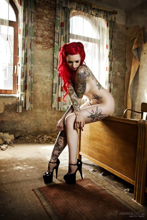 Sexy redhead with tattoos! http://weheartit.com/entry/29954240