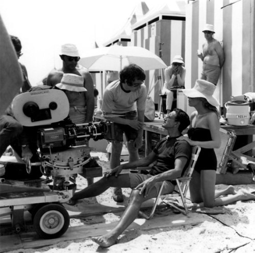 Steven Spielberg, Roy Scheider and Lorraine Gary on the beach filming Jaws.