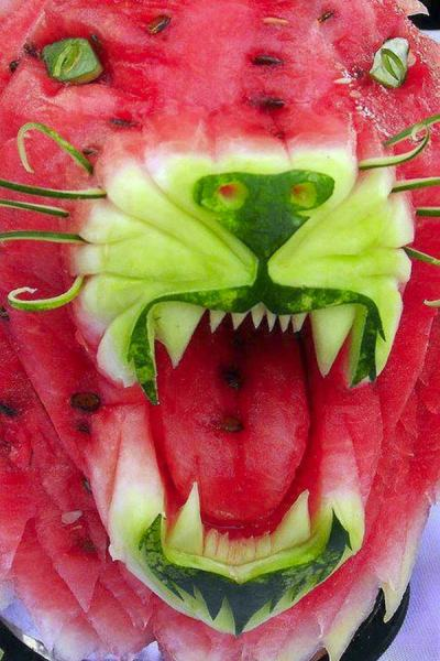 Watermelon Lion carving via www.obviouswinner.com