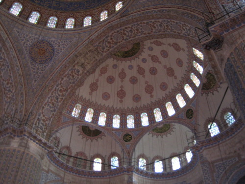 The interior of the Blue Mosque. Unfortunately the dangling lights rather ruin the photo. Istanbul, Turkey.