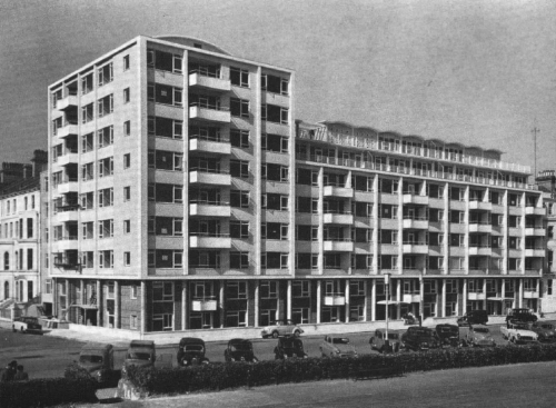 Grandcourt, Eastbourne, East Sussex, UK (circa 1961). Designed by H. Hubbard Ford, Grandcourt stood as a modern intervention in a relatively traditional seaside resort. Providing a total of 55 one to four bedroom flats, the block is 8 storeys tall, with a prominent corner block and an adjacent block with two setback storeys at the top. The lower two floors are set back from circular columns. The block is topped with numerous curved concrete shell roofs.