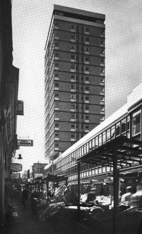 Kemp House, Soho, London (circa 1961). Set within a maze of narrow streets, the 18 storey block was an unexpected high rise feature in the Soho area of London. It is set on top of a 3 storey slab block of shops and offices. It was designed by Riches and Blythin for Westminster City Council as the first large development in response to London County Council's demand for mixed-use schemes in central areas. The block was built using a insitu reinforced concrete structure, faced with brick and reconstructed stone.