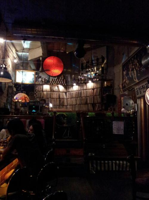 himchi:  partyintherok:  himchi:  partyintherok:  Cool Hongdae vinyl bar I mentioned awhile ago. There doesn't appear to be a Korean name (the Korean sign only says 'gopchang stew') so I guess it is called 'Korean Traditional Sound.' A bit of a walk from the station and bus stops, but worth it!  One of my favourite bars.  Assa!  Yeah, after posting this picture on Facebook and getting a lot of comments about it, I realized that I am the only person who lives in Seoul who has never been here, apparently! Oh well, in my defense, I don't go to Hongdae often… it's kind of far from me. But I love finding new places.  Check out Bar Da if you haven't been there yet.  Mmmf.  I've been there and I don't see what all the fuss is about. It's kind of dirty… I guess it's supposed to be dirty on purpose, but the musty smell really was not appetizing! But the people who work there are really nice. There's a place a few doors down call Chez Robert Artist Cafe that I like much better- there are only a few tables but it has cool decorations, and each month they set up a new art installation. That's more of my thing, but to each his/her own! I can't even begin to imagine all the cool and cute places I'm missing out on in Seoul…