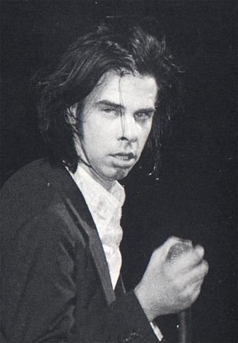 Nick Cave is cross. He has worn a button down shirt out to town but now he feels a little underdressed.