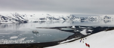 Landscape photography: Heading Home. Deception Island, Antarctica Tourists hiking down the mountainside towards Whalers Bay, Deception Island, South Shetland Islands Source: Adam Burton Photography
