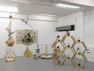 Installation View at Bermondsey Project Space in Group Show 'Connection Point', 2011 Mixed media, including arrows, bronze cast shoes, Chinese medicines, copper fish, drawing, fan, glass casting, Japanese swords, shelving, water