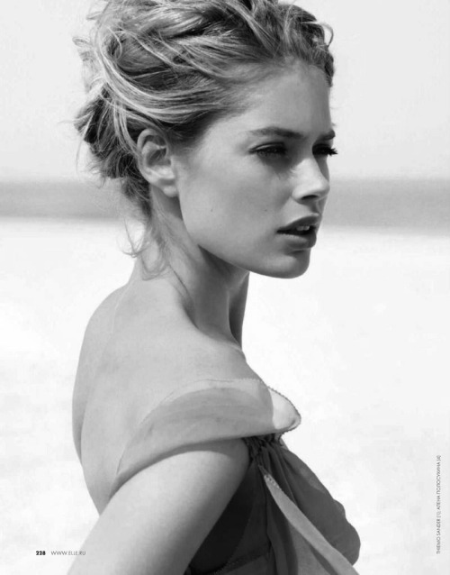 Doutzen Kroes Hits the Beach in Swimwear Looks for Elle Russia June 2012. More? Doutzen Kroes' body.