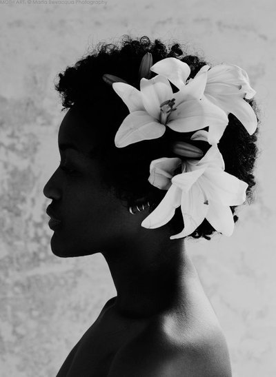 Gorgeous silhouette. care4curls:  Accessorise A TWA with large flowers